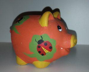 Orangefarbenes Sparschwein - günstig einkaufen und Geld sparen